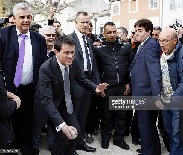 French Prime Minister Manuel Valls plays petanque during a visit in BourgSaintAndeol eastern France on March 20 as part of the campaign for the...