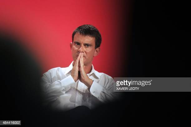 French Prime Minister Manuel Valls ponders at a summer Socialist Party congress in the western city of La Rochelle on August 31 2014 AFP PHOTO /...