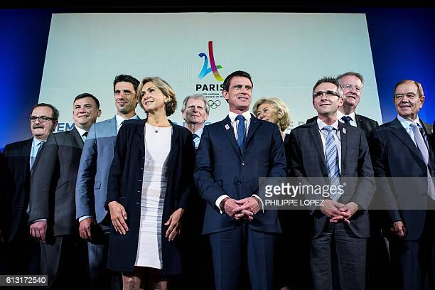 French Prime Minister Manuel Valls poses with officials including President of the IledeFrance region Valerie Pecresse French canoe champion and...