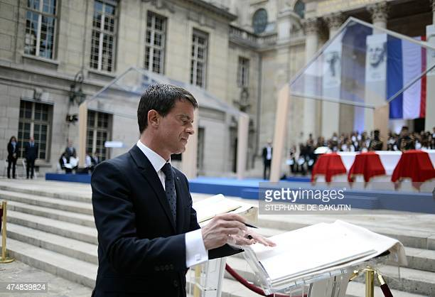French Prime Minister Manuel Valls signs the golden book next to the coffins of four personalities French resistant Genevieve de GaulleAnthonioz...