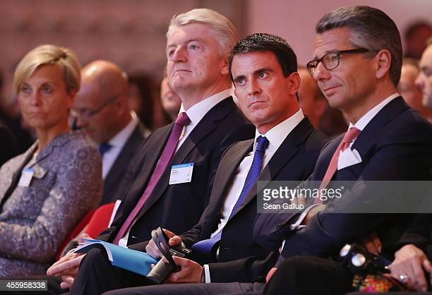 French Prime Minister Manuel Valls sits next to ThyssenKrupp Chairman Heinrich Hiesinger and BDI President Ulrich Grillo at the annual congress of...