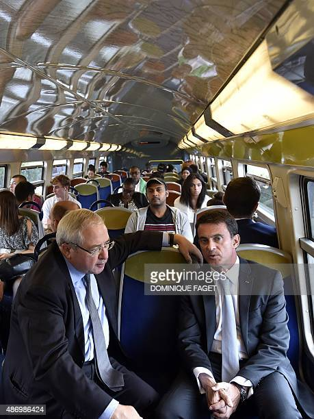 French Prime Minister Manuel Valls speaks with IledeFrance region Paris and Greater Paris area Socialist President JeanPaul Huchon as they travel in...