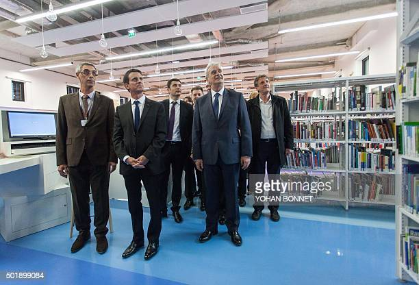 French Prime Minister Manuel Valls stands next to Socialist Party president of the Grand Angouleme cosmopolitan area JeanFrancois Daure mayor of...