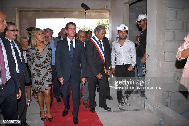 French Prime minister Manuel Valls visits a social housing building site in GignacLaNerthe with the mayor of the city Christian Amiraty on September...