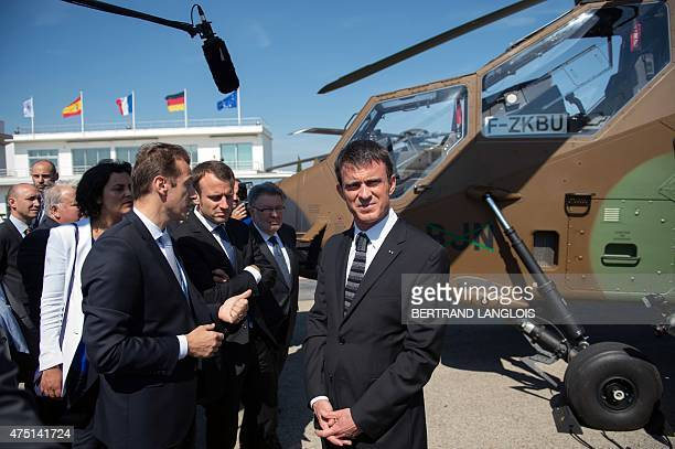 French Prime Minister Manuel Valls visits on May 29, 2015 the Airbus Helicopters factory during a one-day trip to Marignane, southern France,. AFP...