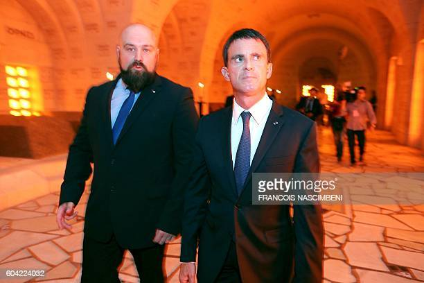 French Prime minister Manuel Valls walks during a ceremony marking the 100th aniversary of the presentation to the city of the Croix de Guerre and...