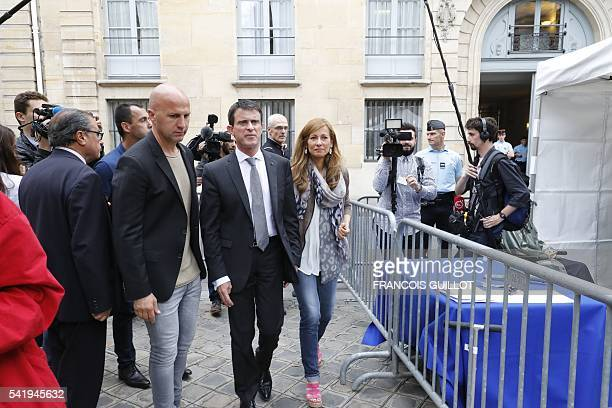 French Prime minister Manuel Valls walks in Hotel Matignon's courtyard with his wife the French violonist Anne Gravoin during the Make Music Day on...