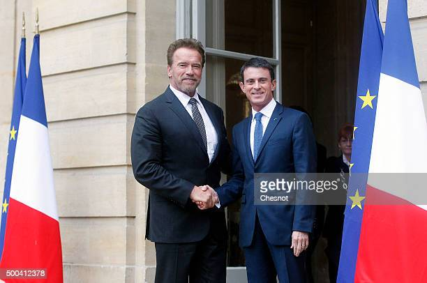 French Prime minister Manuel Valls welcomes Former California governor and US actor Arnold Schwarzenegger prior to attend a meeting at the Hotel...