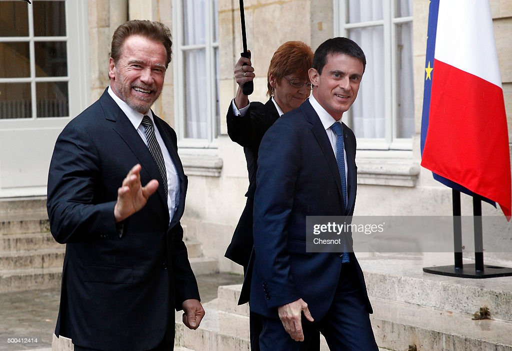 French Prime minister Manuel Valls welcomes Former California governor and US actor Arnold Schwarzenegger prior to attend a meeting at the Hotel Matignon on December 08, 2015 in Paris, France. Arnold Schwarzenegger is in Paris as part of the international mobilization around the COP21.