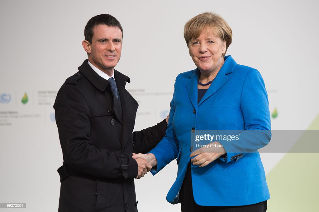 French Prime Minister Manuel Valls welcomes German Chancellor Angela Merkel during the COP21 United Nations Climate Change Conference on November 30, 2015 in Le Bourget, France. More than 150 world leaders are meeting for the 21st Session of the Conference of the Parties to the United Nations Framework Convention on Climate Change (COP21/CMP11), from November 30 to December 11, 2015