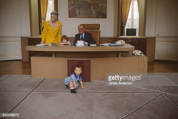 French Prime Minister Pierre Beregovoy his wife Gilberte and their grandchildren in his office at Hotel Matignon