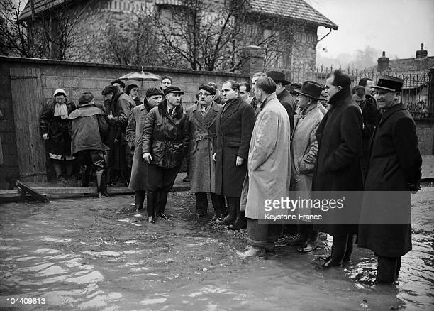 French Prime minister Pierre MENDES FRANCE visited the flooded city of VilleneuveSaintGeorges