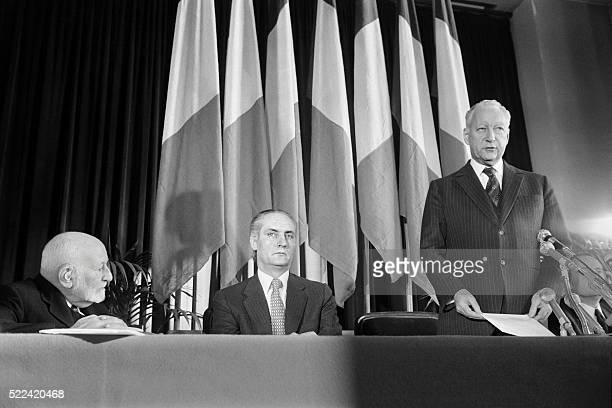 French Prime minister Pierre Messmer delivers a speech along with former politician René Cassin and former Justice minister Jean Taittinger on...