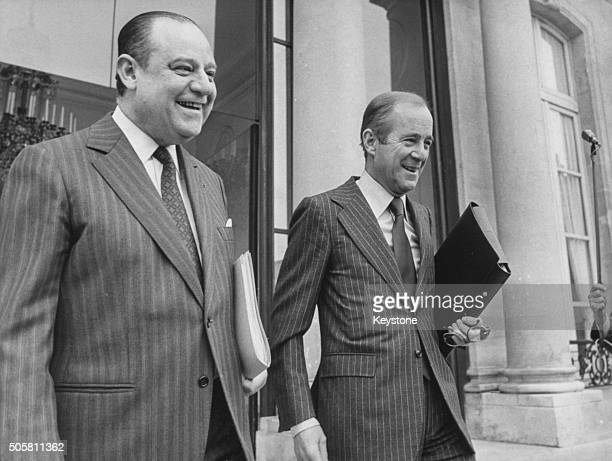 French Prime Minister Raymond Barre and Minister of Foreign Affairs Jean FrancoisPoncet smiling as they leave a government meeting at the Elysee...