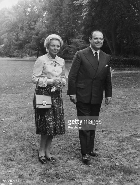 French Prime Minister Raymond Barre out walking in the garden of his official residence the Hotel Matignon in Paris with his wife Eva shortly after...