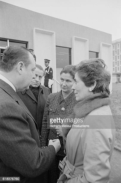 French Prime Minister Raymond Barre speaks to members of his ministerial team Simone Veil and Francoise Giroud Barre and his cabinet just finished...