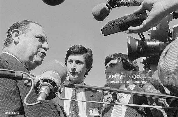 French prime minister Raymond Barre talks to reporters while on an official visit to Morocco. Interviewing him are French journalists Patrick de...
