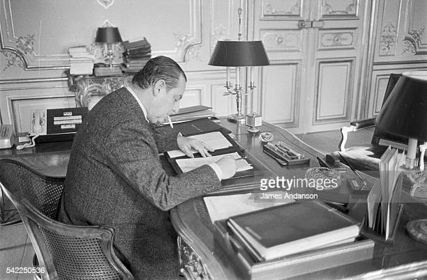 French Prime Minister Raymond Barre works at his desk in Matignon Palace Raymond Barre served as Prime Minister in Valéry Giscard d'Estaing's second...