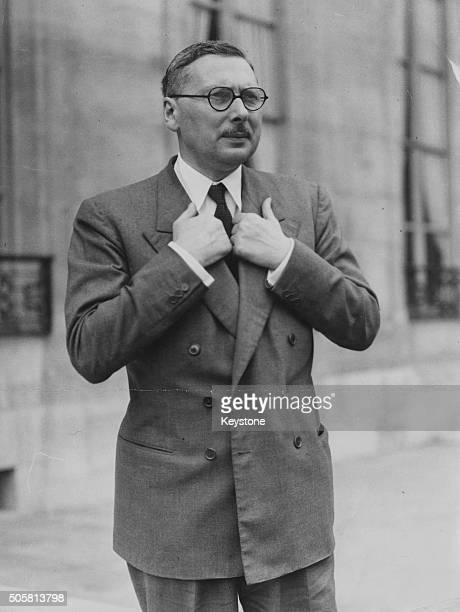 French Prime Minister Rene Pleven with his hands on his lapels as he leaves the Elysee Palace London September 6th 1950