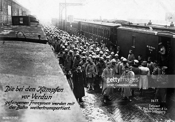 French prisoners being transported by train after the World War 1 battle of Verdun with original German caption reading Die bei den Kämpfen vor...