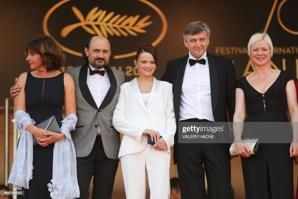 French producer Carine Leblanc, Moldovan actor Valeriu Andriuta, actress Vasilina Makovtseva, Russian director Sergei Loznitsa and Danish producer Marianne Slot pose as they arrive on May 25, 2017 for the screening of the film 'Krotkaya' (A Gentle Creature) at the 70th edition of the Cannes Film Festival in Cannes, southern France. / AFP PHOTO / Valery HACHE