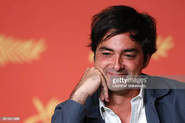 French producer Charles Gillibert smiles on May 17 2016 during a press conference for the film 'Personal Shopper' at the 69th Cannes Film Festival in...