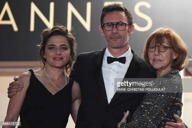 French producer Florence Gastaud French director Michel Hazanavicius and French actress/director and JeanLuc Godard's exwife Anne Wiazemsky pose as...