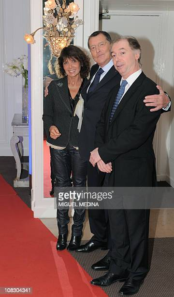 French producer Jean-Claude Camus welcomes ex-wife of singer Michel Fugain Stephanie Fugain and French comic Philippe Chevallier before receiving the...