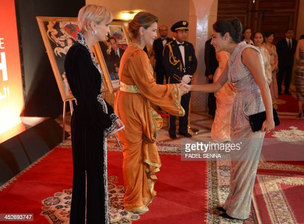 French producer Melita Toscan du Plantier looks on while Moroccan Princess Lalla Meryem receives Iranian actress Golshifteh Farahani at the 13th...