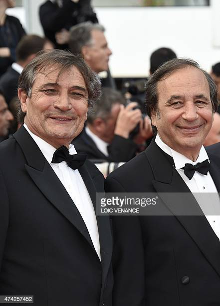 French producer Tony Comiti and French photographer Richard Melloul pose as they arrive for the screening of the film Dheepan at the 68th Cannes Film...