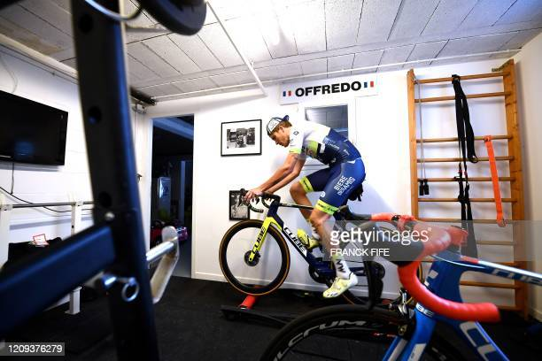 French professional cyclist Yoann Offredo of Wanty-Gobert Cycling Team trains in the garage of his house, converted into a sports room, on April 3 in...