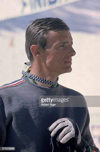 French professional downhill skier Jean-Claude Killy in profile as he wears a sweater and gloves with his goggles around his neck at a ski slope,...