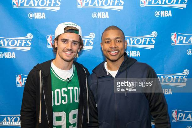 French professional footballer Antoine Griezmann meets Isaiah Thomas of the Boston Celtics prior to Game Five between the Cleveland Cavaliers and...