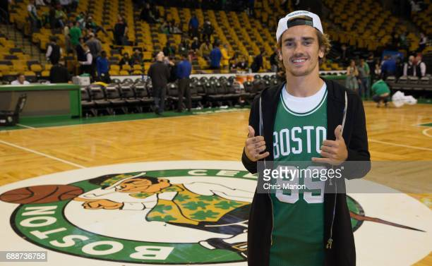French professional footballer Antoine Griezmann poses for a photo on the court prior to Game Five between the Cleveland Cavaliers and Boston Celtics...