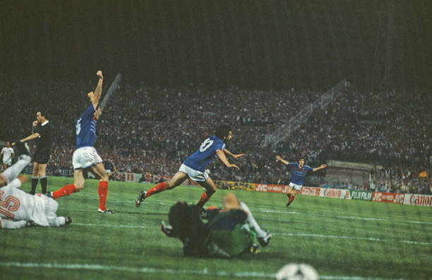 French professional footballer Michel Platini turns away after scoring the winning goal for the France national team after 119 minutes of play in the...