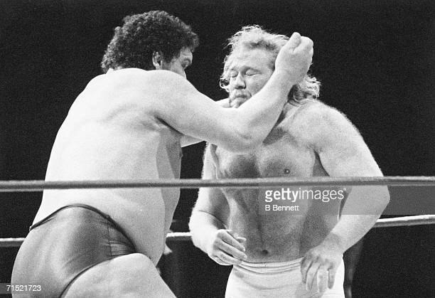 French professional wrestler and actor Andre the Giant fights American colleague Big John Studd in the ring 1980s Andre wrestled from 1964 to 1993...
