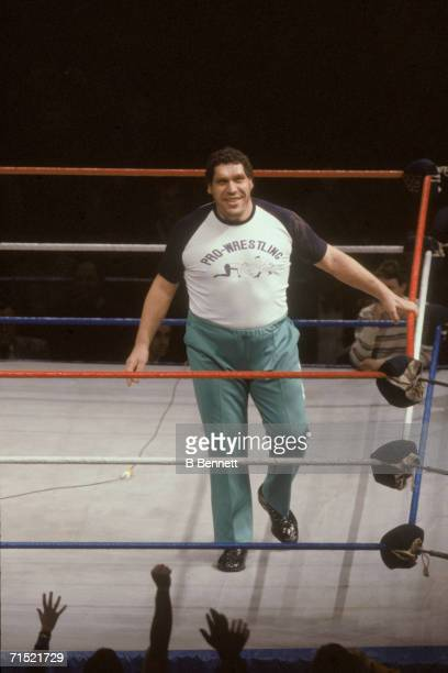 French professional wrestler and actor Andre the Giant smiles as he walks around in the ring as a special guest referee for the match with Rowdy...