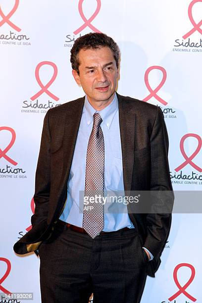 French professor and President of the Scientific and Medical Committee of Sidaction Yves Levy poses on March 12 2012 as he arrives at the Quai Branly...