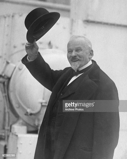 French Professor of Applied Psychology Emile Coue waves from the deck of a ship circa 1923