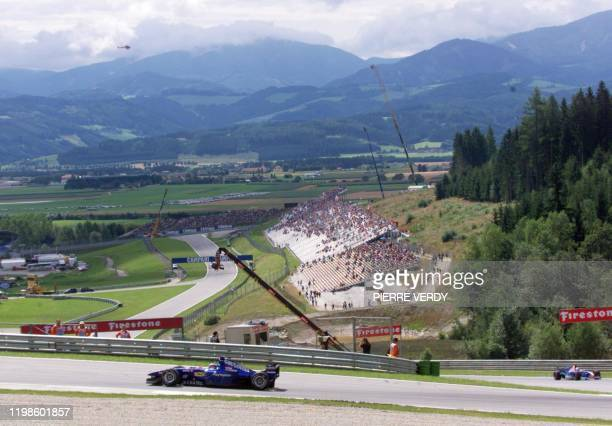 French ProstPeugeot driver Olivier Panis steers his car on the racetrack during the first free practice session in Spielberg 23 July two days before...