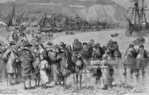 French Protestant Huguenot refugees arriving on the English coast at Dover in Kent, 1685. They are fleeing religious persecution in France, after...