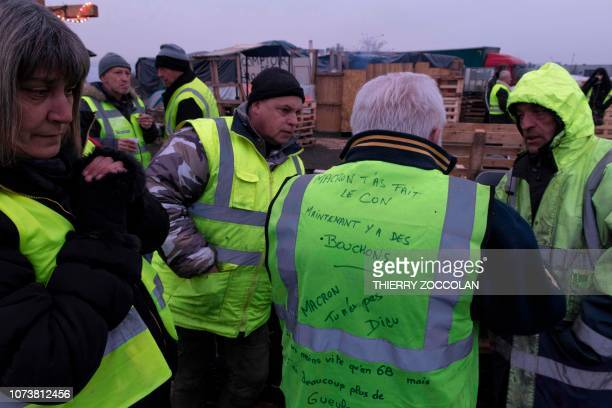 French protester Daniel aka Papy Cool wearing a yellow vest reading 'Macron you've been stupid Now you have traffic jam Macron you are not God' chats...