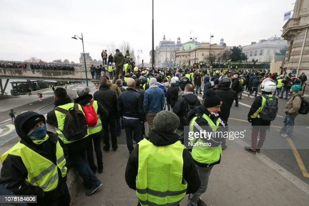 French protesters wearing yellow vests gather on the Leopold Sedar Senghor Bridge to protest against rising oil prices and deteriorating economic...