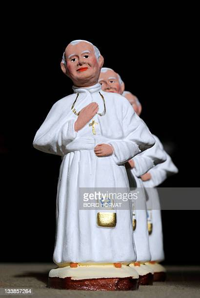 French Provence region handpainted figurines called 'Santons' showing Pope John Paul II are displayed on a stall during the yearly Santon Fair in the...