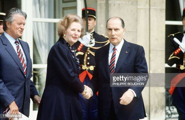 French Président François Mitterrand and Foreign Minister Roland Dumas welcome British Prime Minister Margaret Thatcher 04 May 1984 in front of the...