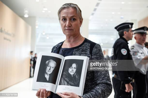 French pulmonologist Irene Frachon poses with a photobook depicting portraits of mediator victims as she arrives on September 23 2019 at Paris'...