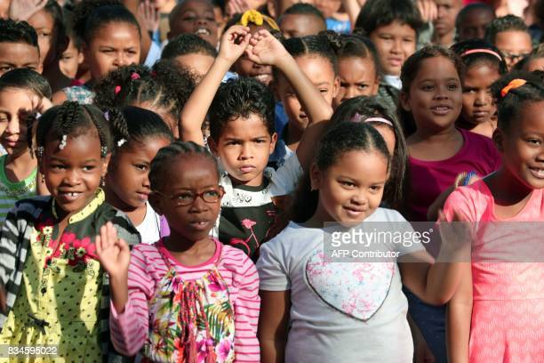 French pupils gather in the schoolyard at Michel Debre elementary school on the first day of the new school year in SaintDenis de la Reunion on the...