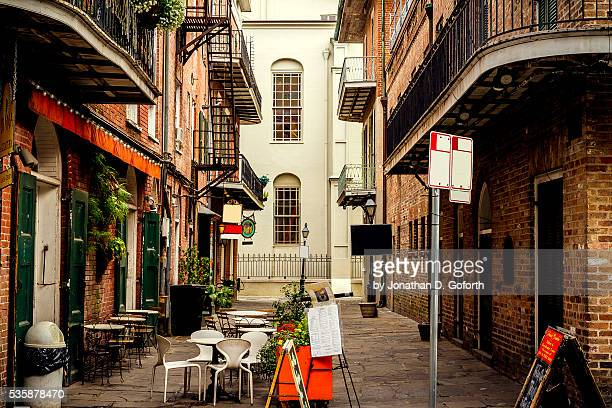 french quarter alley - new orleans french quarter stock photos and pictures