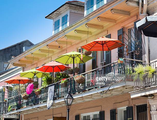 French Quarter Balcony With Colorful Umbrellas and Wrought Iron Railings
