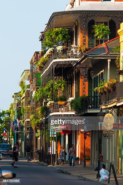 french quarter neighborhood street scene - new orleans french quarter stock photos and pictures
